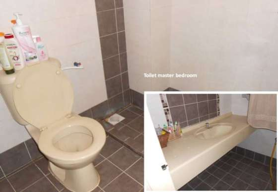 Toilet in Master Bedroom